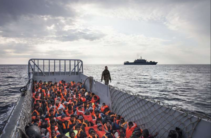 186 people rescued at sea being transferred to a bigger vessel – UNHCR/A. D'Amato